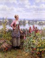 Maria on the Terrace with a Bundle of Grass Landfrau Daniel Ridgway Knight Blumen